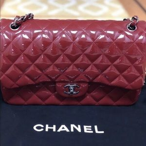 Chanel large flap red patent leather bag
